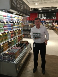 Southeastern Grocers President and CEO, Ian McLeod, shows off one of his favorite local microbrews, from the nearby Veterans United brewery, at the new Winn-Dixie Baymeadows.