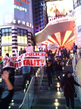 Marching down from Planet Hollywood. Photo by Jason Nellis