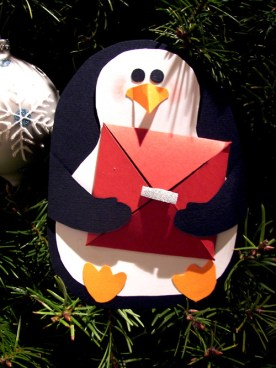 2010 Christmas Penguin. Easily made: Black, White, and Orange cardstock paper, scissors, and glue. I found a penguin online and traced the shapes. Each penguin carried a small envelop with a hidden message.
