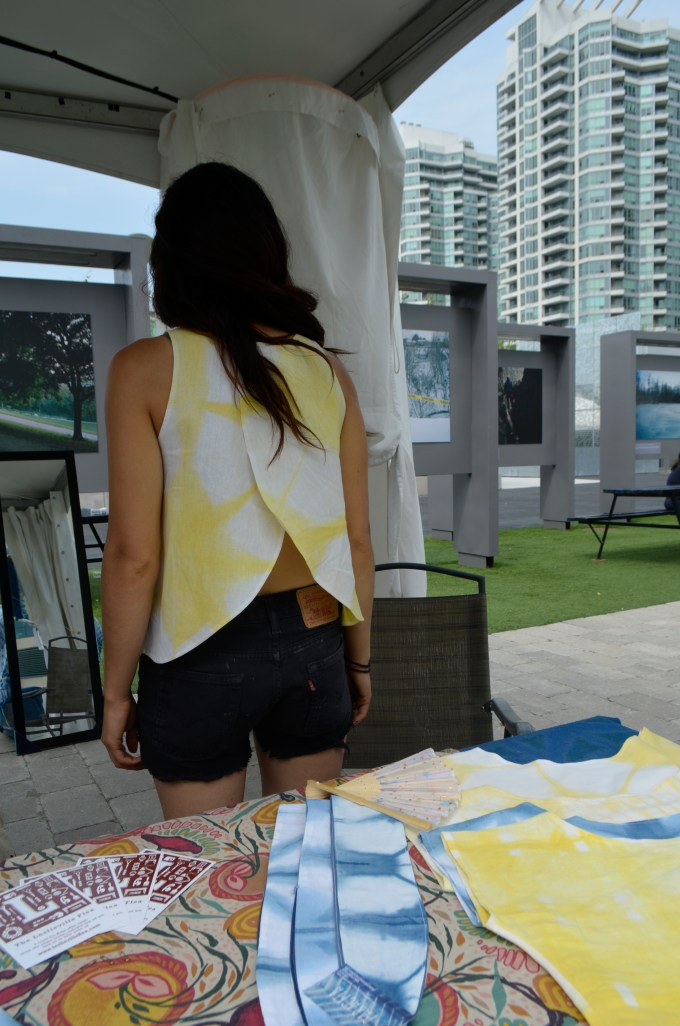 one of the Paracita designers models their yellow trapeze top