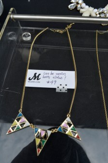 two-sided graphic triangle necklace at Muizee