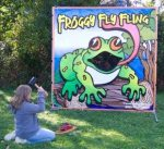 """Frog themed carnival game called """"Froggy Fly Fling""""."""