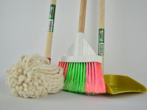 Cleaning mops on a white surface.