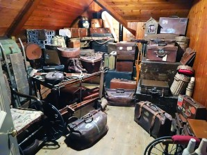 A room full of stacked bags and suitcases