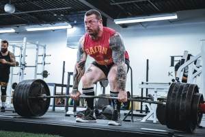 A man performing a deadlift, getting himself ready for moving robust items