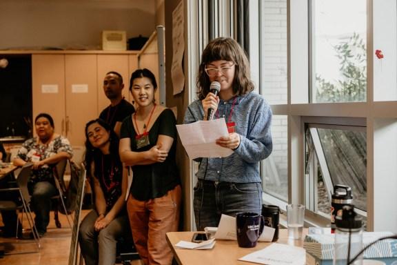 Reiko Pleau, ensoku co-organizer, makes an announcement to event participants on Saturday morning.