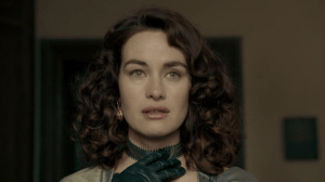 Milady de Winter stares offscreen, gloved hand at the ribbon at her neck.