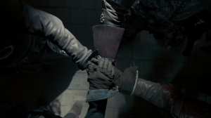 The four musketeers' hands laid on top of one another.