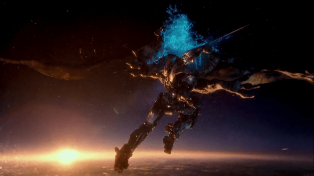 At the edge of space, Gipsy Danger cuts through Otachi, a flying kaiju, with a sword jutting from its wrist.