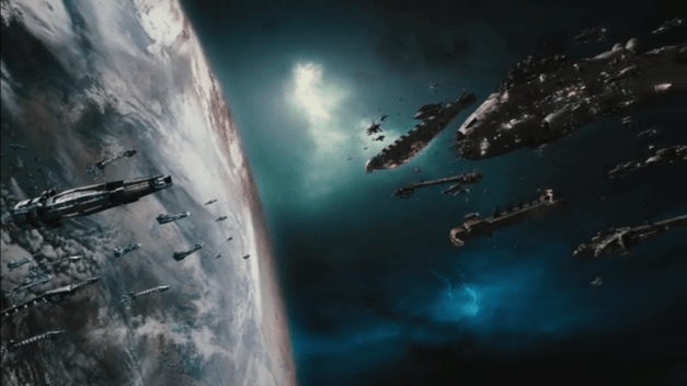 Two fleets of spaceships, one shiny and neat, the other ragged, face one another across the backdrop of a planet's orbit.