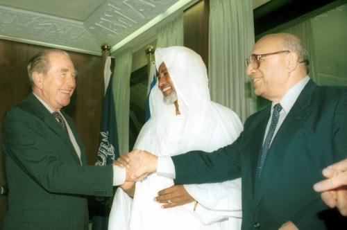 The President of Israel, Chaim Herzog, welcomed Saudi Sheikh Shuha Ishak Idris to his official residence. On the right, Israeli businessman, Yaakov Nimrodi