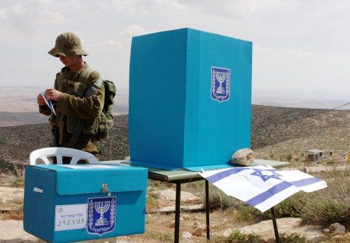 Soldier casting a ballot