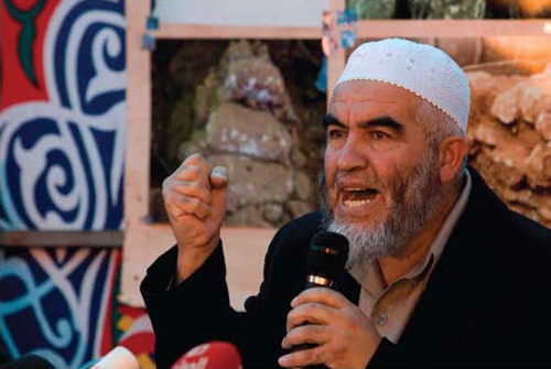 """Sheikh Raed Salah, head of the northern branch of the Israeli Islamic Movement. He became the successor of Haj Amin al-Husseini, refurbished the """"Al-Aksa is in danger"""" libel, incited violence, and promised to redeem Al-Aksa """"in fire and blood."""" (Tara Todras-Whitehill, Associated Press)"""
