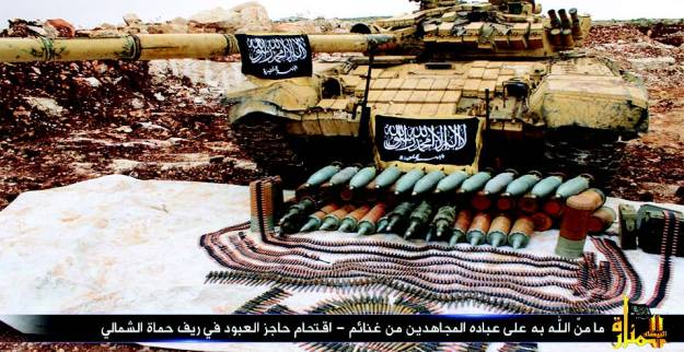Jihadists demonstrate capability to subdue Syrian conventional units. Pictured here is  a captured Syrian T-72V-AT tank (with reactive armor) flying the Jabhat al-Nusra flag