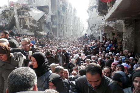 Refugees wait in line to receive food aid distributed in the Yarmouk camp on January 31, 2014 in Damascus, Syria. (United Nation Relief and Works Agency - UNRWA) The Arab World Turns Its Back on the Palestinians