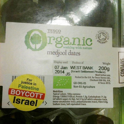 Israeli dates in an Ireland grocery store marked with yellow boycott stickers
