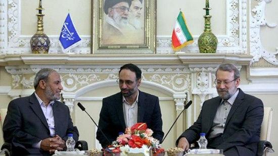 Hamas leader Mahmoud al-Zahar (l) meeting with Ali Larijani (r) in 2012.  (Translator in between.)