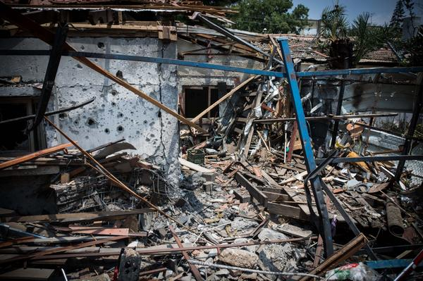 A rocket fired from the Gaza Strip on July 22, 2014, struck this house in the Israeli town of Yehud, a short distance from Ben-Gurion Airport. (IDF/Twitter)