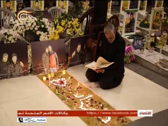 Soleimani praying at the younger Mughniyeh's grave