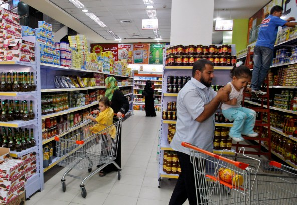 Palestinians shop at al-Andulusia mall in Gaza City on Aug. 16, 2011. (AP/Hatem Moussa)