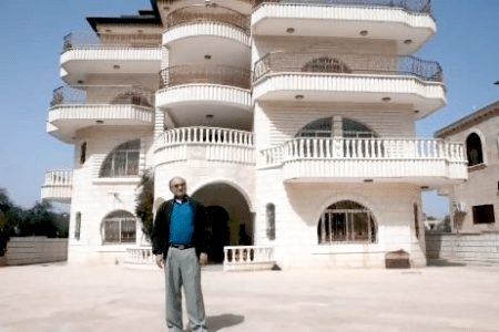 Ahmed Kassem in front of his villa of in the West Bank village of Turmus Aya