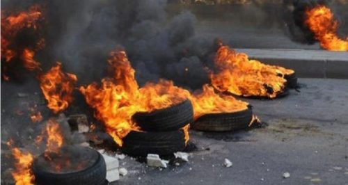Burning tires in Nablus.