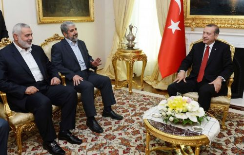 Recep Tayyip Erdogan, then Turkish Prime Minister, (right) during a meeting with Khaled Mashal, the Hamas chief in exile, center, and Gaza's prime minister Ismail Haniyeh in Ankara, Turkey, June 18, 2013.