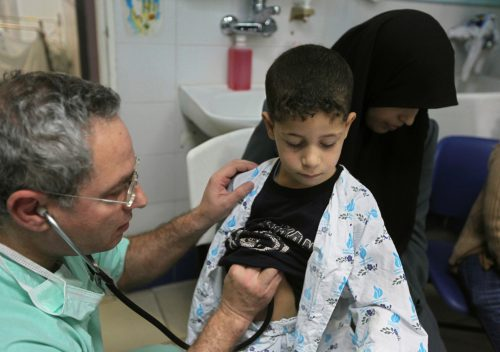 Abdullah Siam is examined by Dr. Lior Sasson, in an Israeli hospital