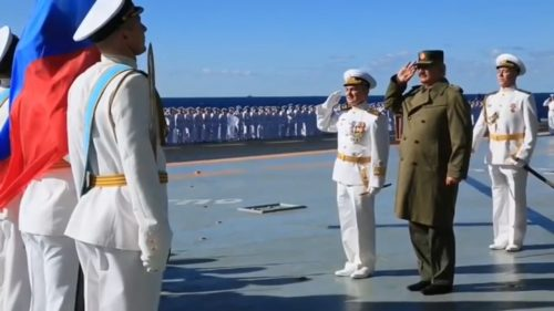 Field Marshal Khalifa Haftar (right) on board the Russian aircraft carrier on January 11, 2017