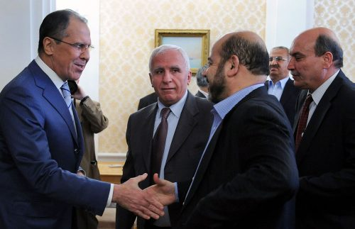 Russian Foreign Minister Sergei Lavrov (left) greets Hamas' Mousa Mohammed Abu Marzook. In the middle is Fatah's Azzam al-Ahmad