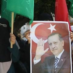 Hamas supporters hold portraits of Recep Tayyip Erdogan