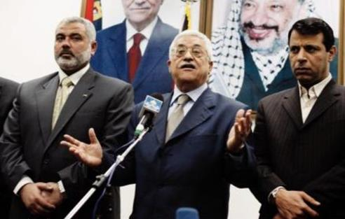 Mahmoud Abbas flanked by Hamas' Ismail Haniyeh (left) and Mohammed Dahlan