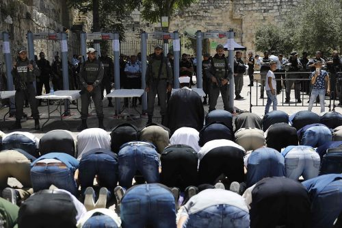 Muslim worshipers outside of the Temple Mount and the metal detectors.