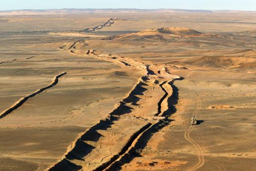 Morocco's 2,700 km long berm wall dividing Western Sahara. Tens of thousands of Moroccan soldiers are based along it with millions of landmines.