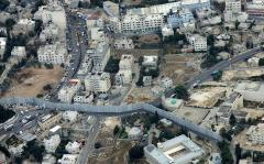 An aerial view shows Israel's security barrier between Abu Dis and Jerusalem