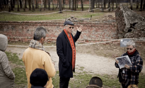 Professor Mohammed Dajani in front of the ruins of a crematorium at Auschwitz
