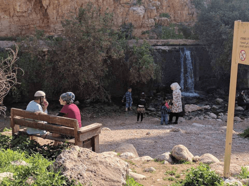 Arabs and Jews enjoy a natural spring in the Jerusalem area