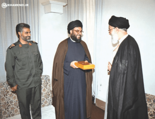 Ayatollah Khamenei presenting a copy of Quran to Sayyed Hassan Nasrallah, with Major General Soleimani in attendance.
