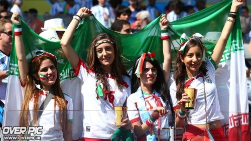 Young Iranian girls outside of Iran encourage their national team without wearing head coverings.
