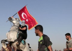 Gazan protestor, riding a horse, holds a Turkish flag
