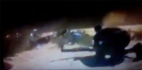 Hamas incursion unit illuminated by an IDF flare.