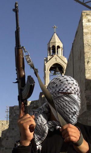 A masked Palestinian