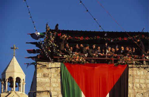 Yasser Arafat, addresses an enthusiastic crowd in Bethlehem