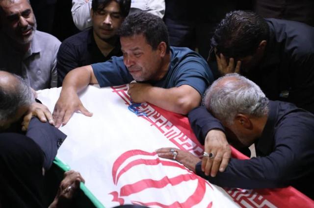 Sarabian's casket draped in an Iranian flag