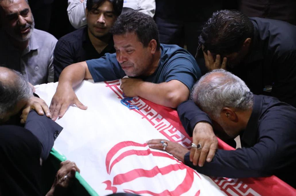 Sarabian's casket draped in an Iranian flag