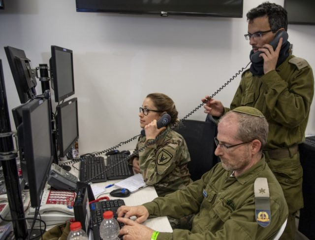 U.S. and Israeli officers in a command post