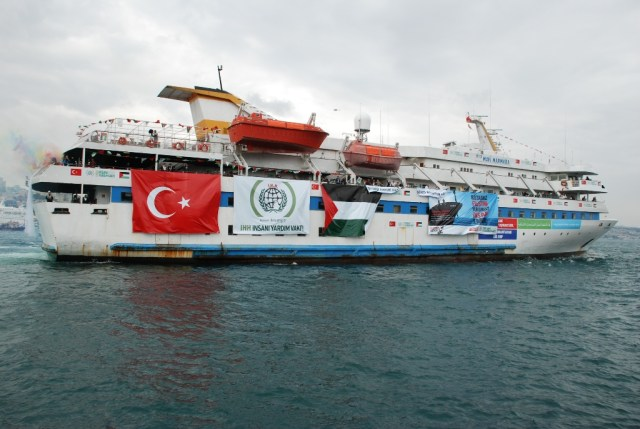 The Mavi Marmara, bedecked with Turkish, Palestinian, and the IHH flag