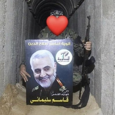 Photograph of Qasem Soleimani held by an Islamic Jihad fighter in one of the tunnels in the Gaza Strip