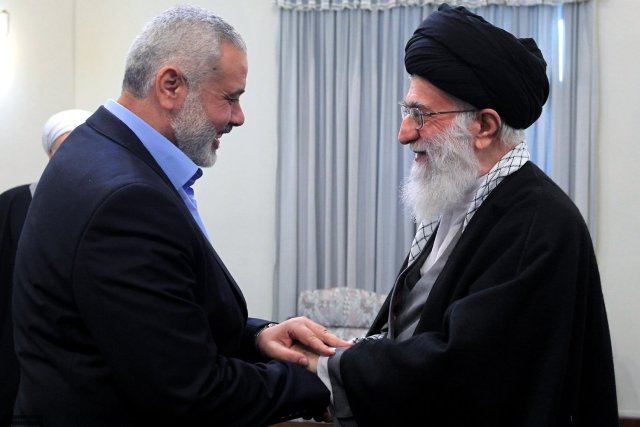 Iran's Supreme Leader Khamenei embraces Hamas leader Ismail Haniyeh.