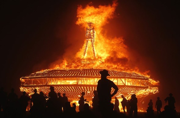 The Man burns during the Burning Man 2013 arts and music festival in the Black Rock Desert of Nevada, on August 31, 2013. The federal government issued a permit for 68,000 people from all over the world to gather at the sold out festival, which is celebrating its 27th year, to spend a week in the remote desert cut off from much of the outside world to experience art, music and the unique community that develops. (Reuters/Jim Urquhart via The Atlantic)